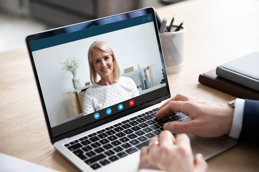 bigstock-Old-Woman-Holding-Video-Call-W-357909314